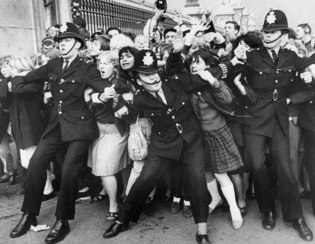 "October 26, 1965 - Beatles fans try to break through a police line at Buckingham Palace in London where the group were due to receive the Member of the British Empire (MBE) decoration from the Queen. The Beatles' debut tune that launched Britain into the '60s and helped to ignite a worldwide obsession for the four-man British rock band celebrates its 50th anniversary on October 5, 2012. Even though it only peaked at no. 17 on the British charts, the single ""Love Me Do"" was the rock group's first hit record when released in October 1962. (GettyImages)"